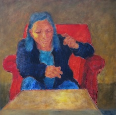 Woman in a red armchair